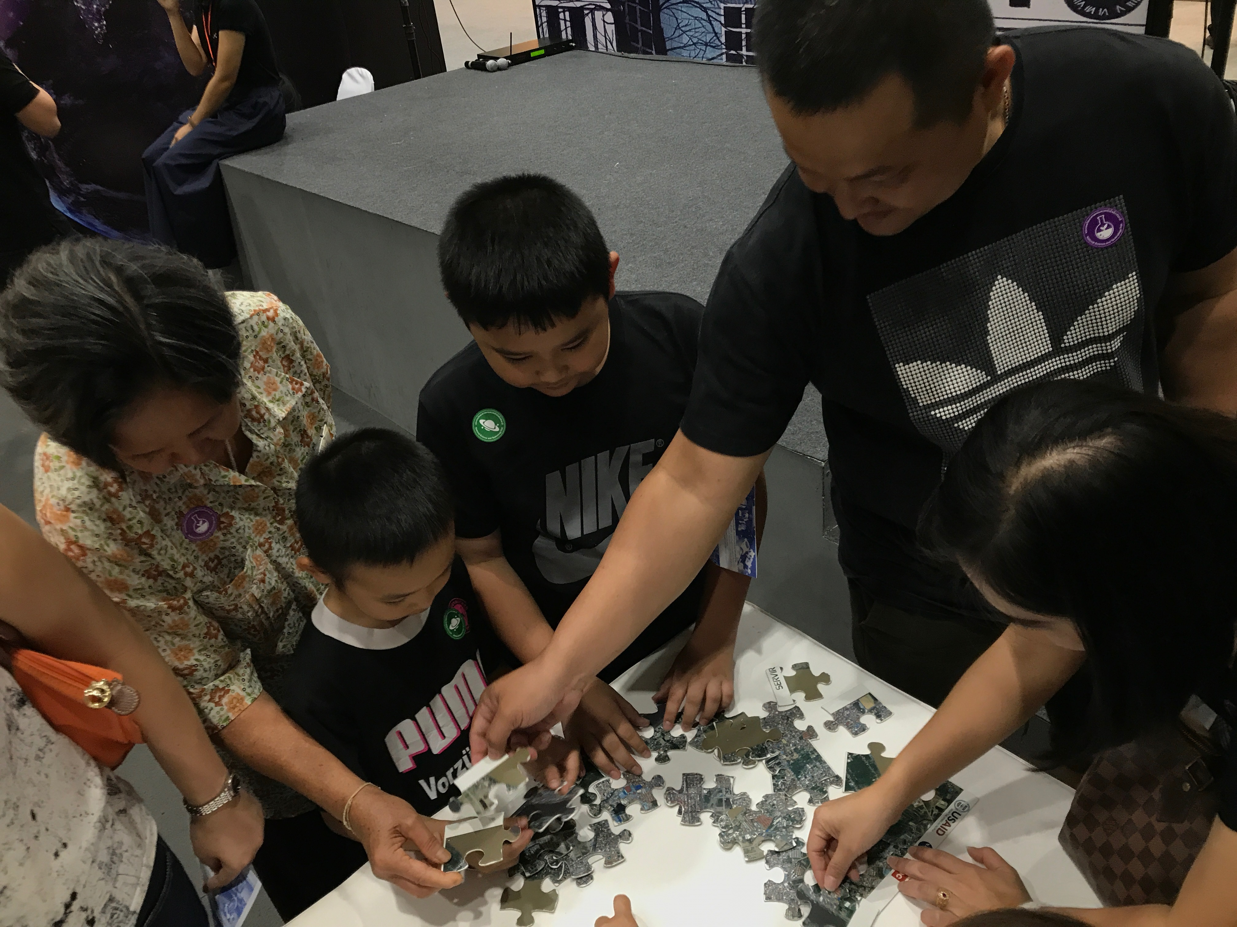 Kids and families connecting GIS puzzle